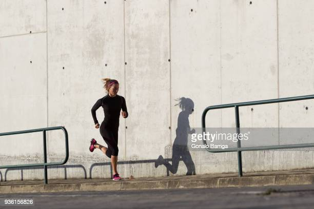 young woman jogging - uphill stock pictures, royalty-free photos & images