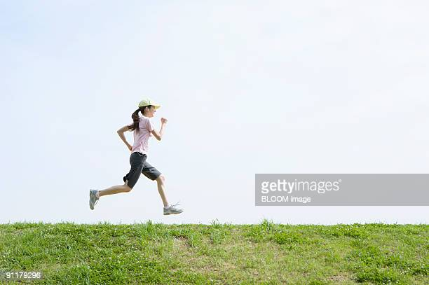 Young woman jogging, side view