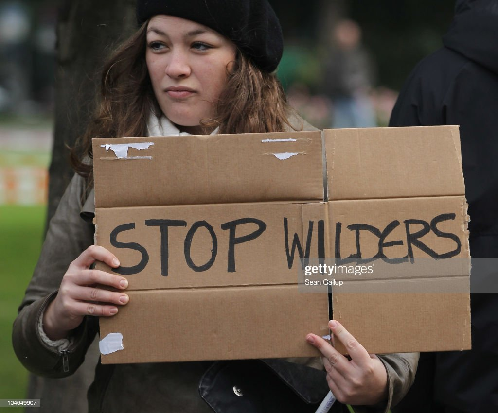A young woman joins protesters outside a hotel where Dutch right-wing politician Geert Wilders spoke to supporters on October 2, 2010 in Berlin, Germany. Wilders came on the invitation of German renegade former Christian Democrat (CDU) Rene Stadtkewitz, an outspoken Islam critic, to speak to approximately 500 supporters in Berlin. Wilders is seeking to create an international alliance of critics of Islam, called the 'International Freedom Alliance,' in Germany, France, the United Kingdom, Switzerland, Denmark, the United States and the Netherlands.