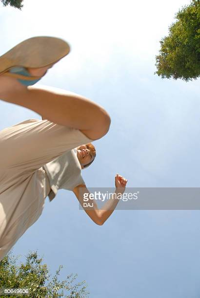 young woman jumping, blurred motion - 靴底 ストックフォトと画像