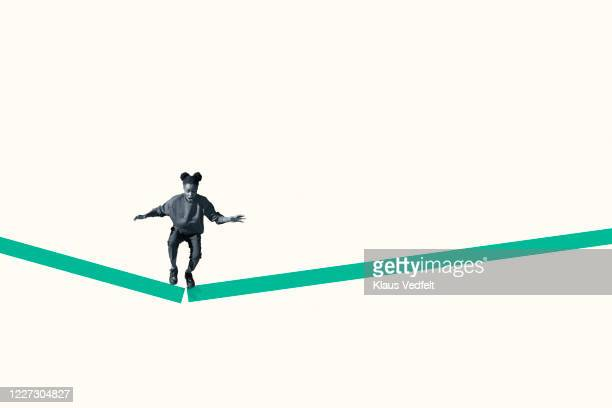 young woman jumping from broken green ramp - graphic accident photos stock pictures, royalty-free photos & images