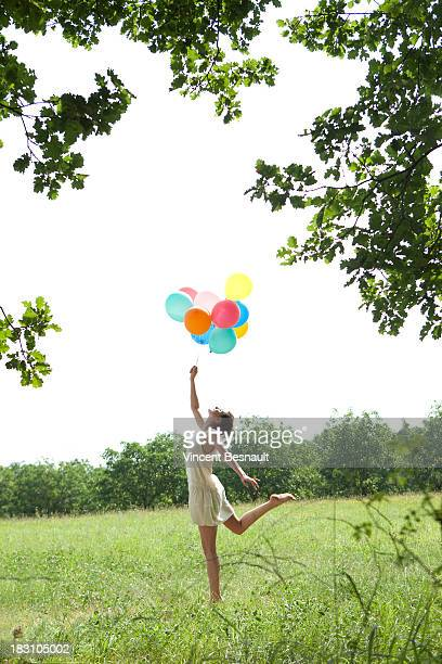 Young woman jumping in a field