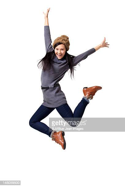 Young woman jumping in mid-air