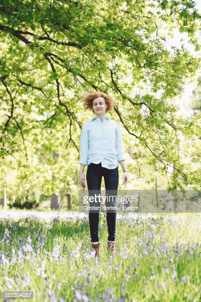 young woman jumping in the park - bortes stock pictures, royalty-free photos & images