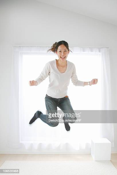 Young Woman Jumping in the Room