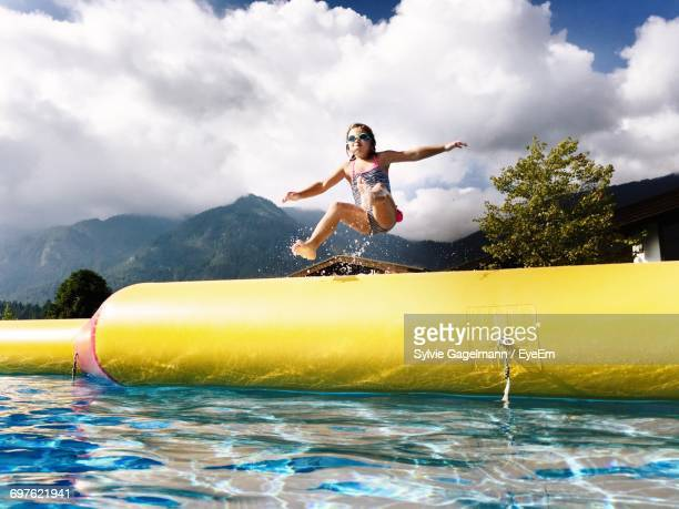 Young Woman Jumping In Water