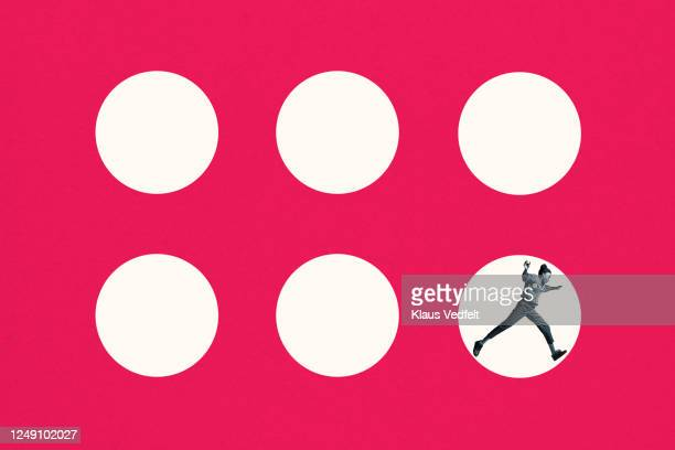 young woman jumping in white circle - individuality stock pictures, royalty-free photos & images
