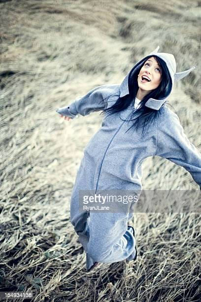 Young Woman Jumping In Wolf Costume