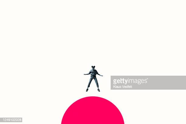 young woman jumping on vibrant pink semi-circle - hot pink stock pictures, royalty-free photos & images
