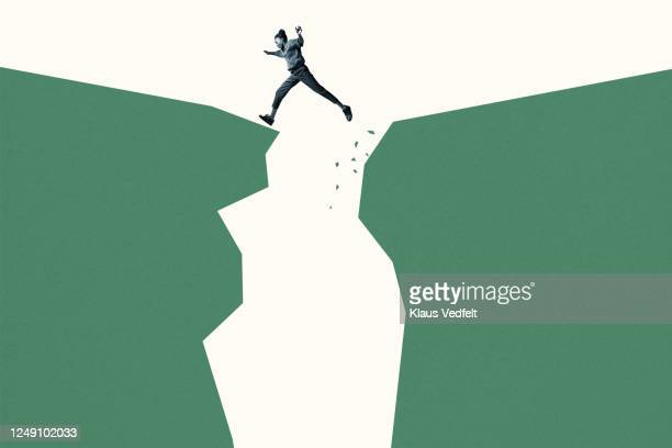 young woman jumping over green cliffs - positive emotion stock pictures, royalty-free photos & images