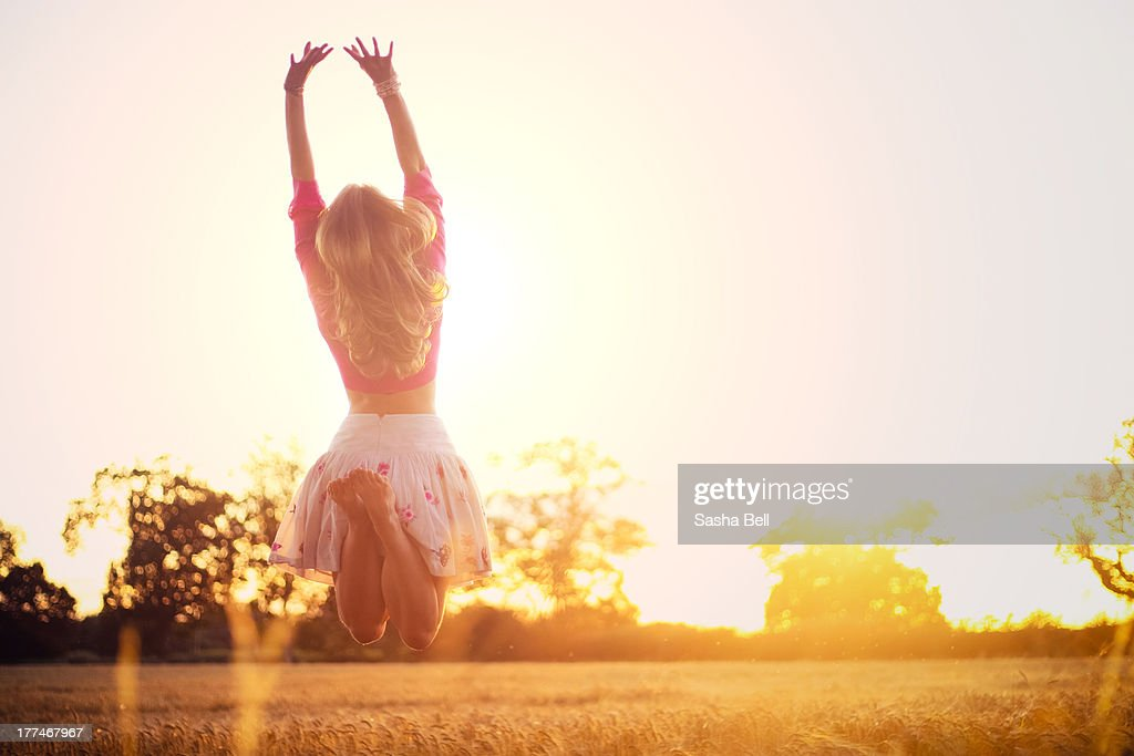 Young woman jumping : Stock Photo