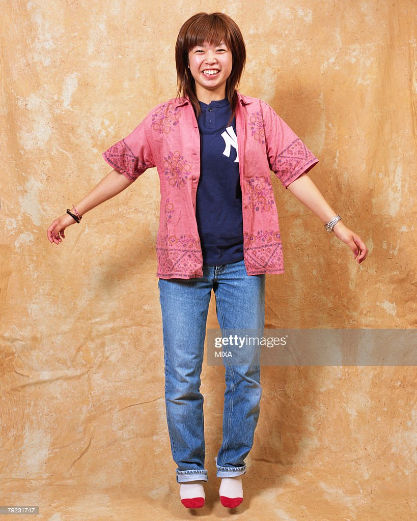 A young woman jumping : Stock Photo
