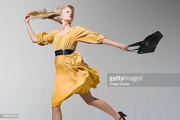 a young woman jumping - handbag stock pictures, royalty-free photos & images