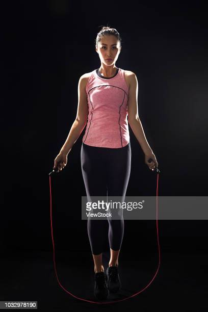 young woman jumping rope - skipping along stock photos and pictures