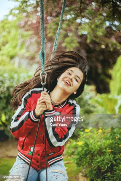 young woman just swinging with crazy hair