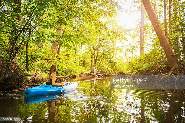 young woman kayaking on forest river, cary, north carolina, usa - north carolina photos et images de collection