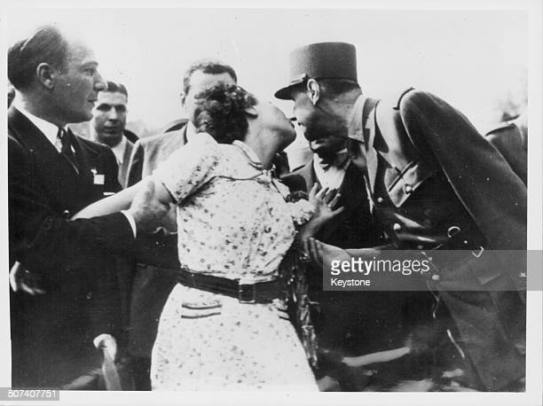 A young woman kissing French General Charles de Gaulle during the celebrations for the liberation of Paris 1944
