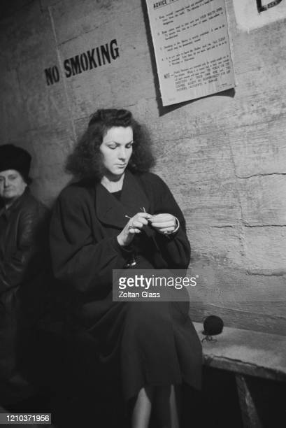 A young woman knitting in an air raid shelter during the Blitz London October 1940 Original Publication Picture Post 308 Shelter Life pub 26th...