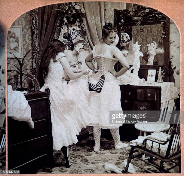 Young Woman Lacing Up Another Woman's Corset Single Image of Stereo Card 1897