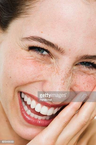 Young woman laughing, close up, portrait