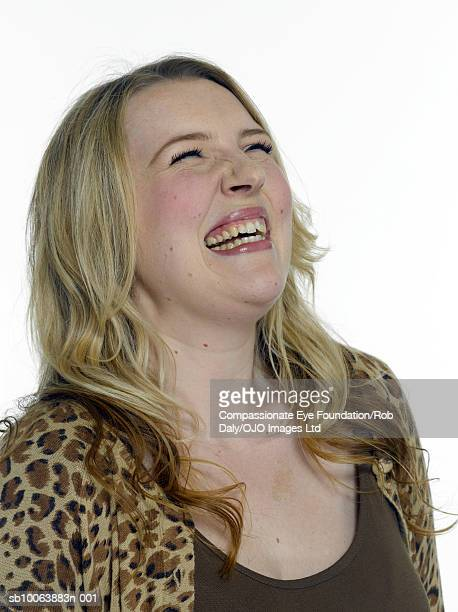 """young woman laughing, eyes closed, close-up - """"compassionate eye"""" fotografías e imágenes de stock"""