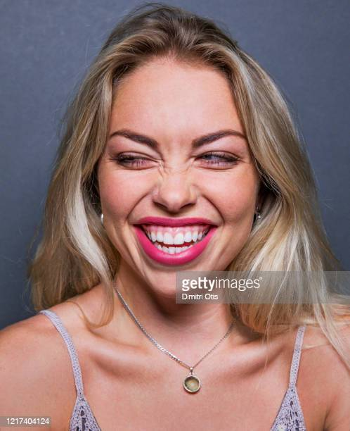 young woman laughing hysterically - hysteria stock pictures, royalty-free photos & images