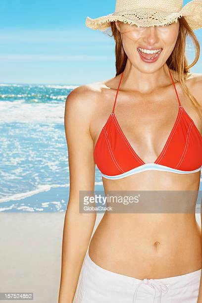 young woman laughing in bikini top on the beach - bikini top stock pictures, royalty-free photos & images