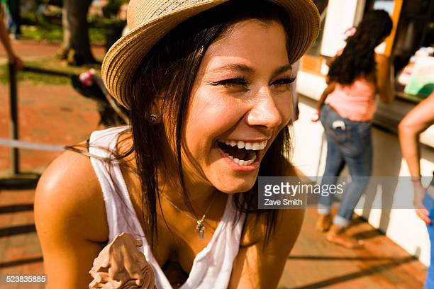 Young woman laughing in park