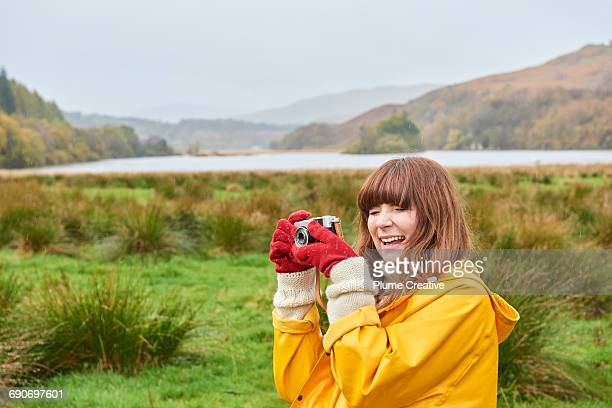 Young woman laughing, in Scottish landscape