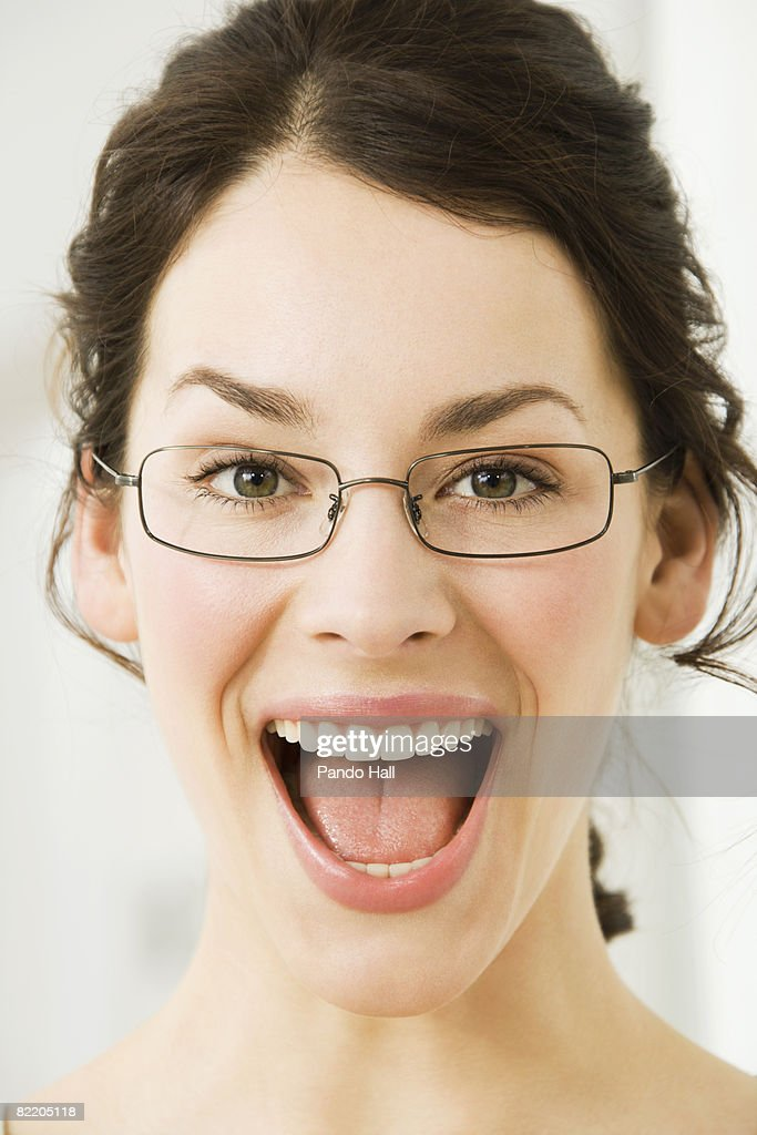 Young woman laughing, mouth wide open : Stock Photo