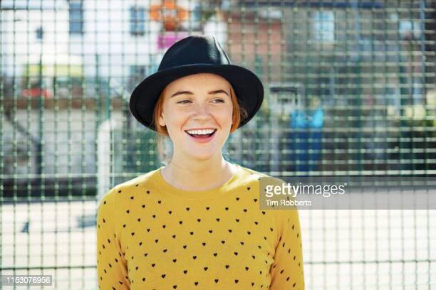 young woman laughing off camera - street style stock pictures, royalty-free photos & images