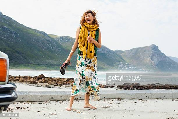 young woman laughing on beach, cape town, western cape, south africa - wind blows up skirt stock pictures, royalty-free photos & images