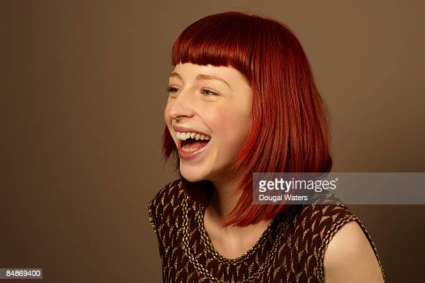 young woman laughing. - fringe stock pictures, royalty-free photos & images