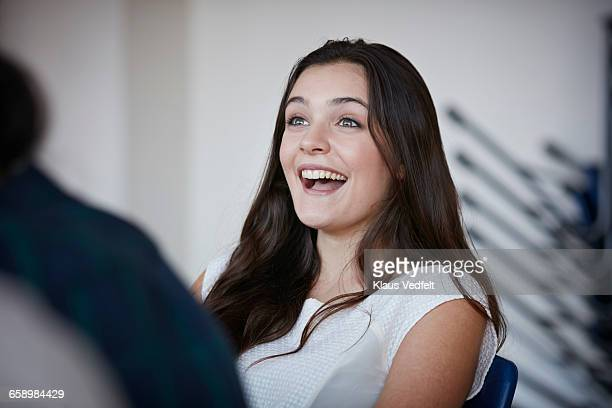 young woman laughing with co-students - surprise stock pictures, royalty-free photos & images