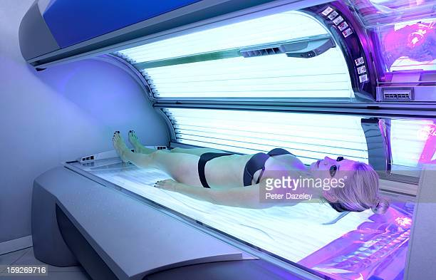 Young woman laying on sunbed