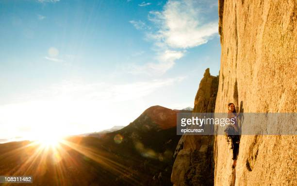 young woman leading a climbing route in colorado - boulder rock stock pictures, royalty-free photos & images