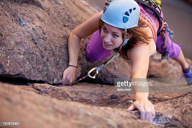 young woman leading a climbing route in colorado - rock climbing stock pictures, royalty-free photos & images