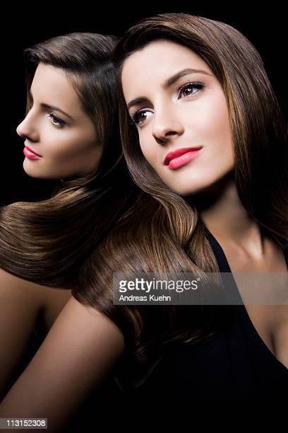 young woman leaning against mirror. - dominican ethnicity stock photos and pictures