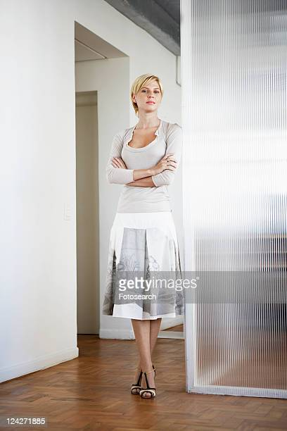 Young woman leaning on glass wall