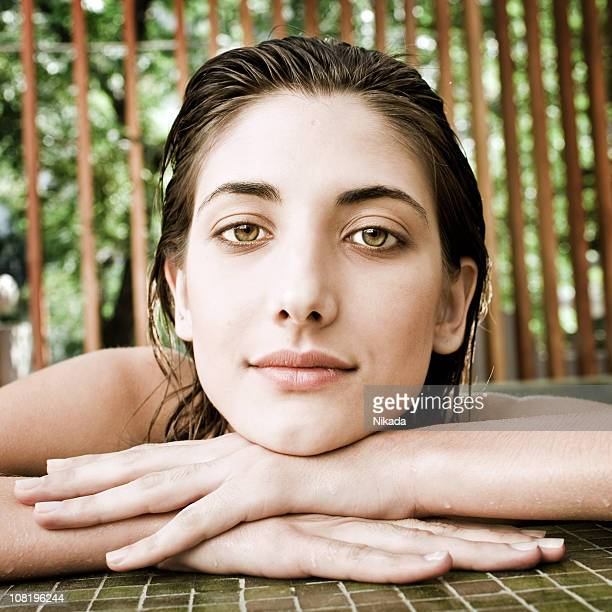 young woman leaning on pool edge - hazel eyes stock pictures, royalty-free photos & images
