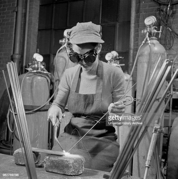 Young Woman Learning to Weld, Six Nights per Week, at Work Projects Administration Vocational School in Preparation to Work on Assembly Line in a War...