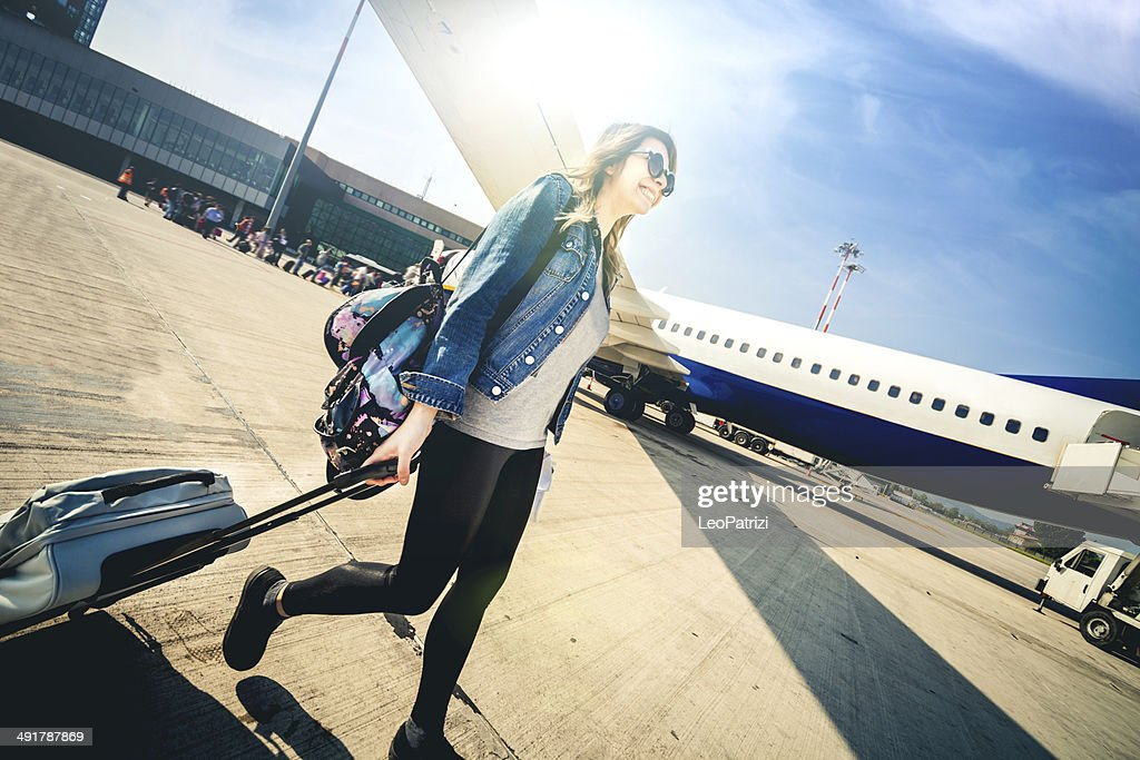 Young woman leaving for vacations : Stock Photo