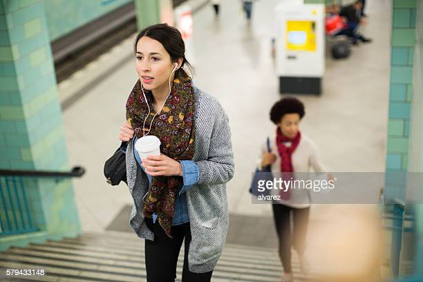 Young woman leaving subway station