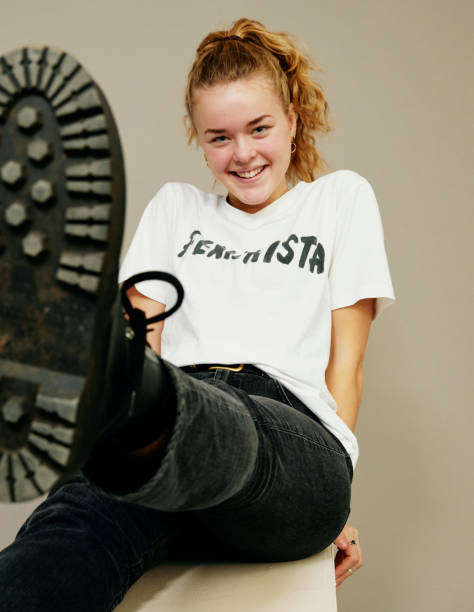 Young woman lifting her foot towards the camera.