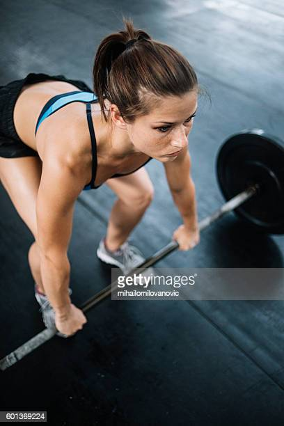 Young woman lifting weights