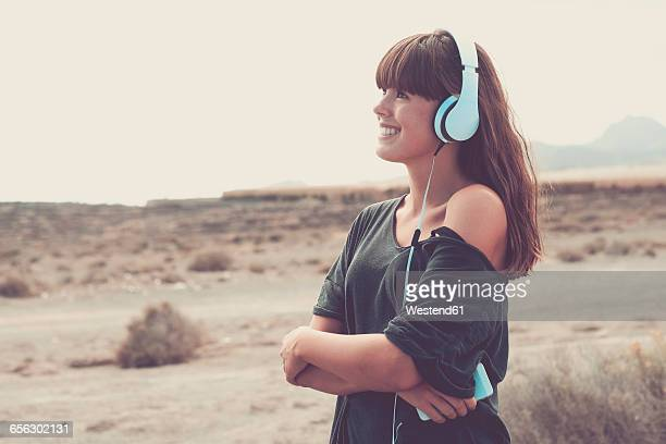 Young woman listening music, smiling happily