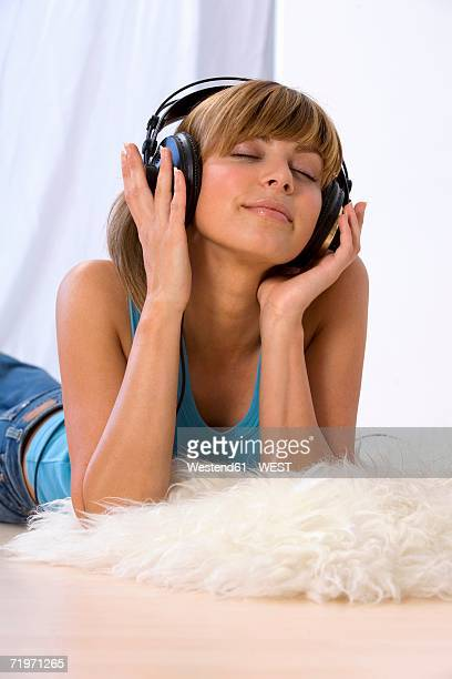 Young woman listening to music, eyes closed