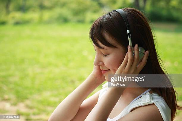 young woman listening to music,healthy lifestyle