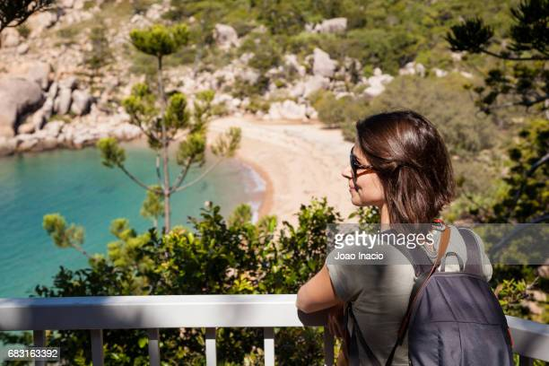 young woman looking at arthur bay, magnetic island, queensland, australia - townsville queensland stock pictures, royalty-free photos & images