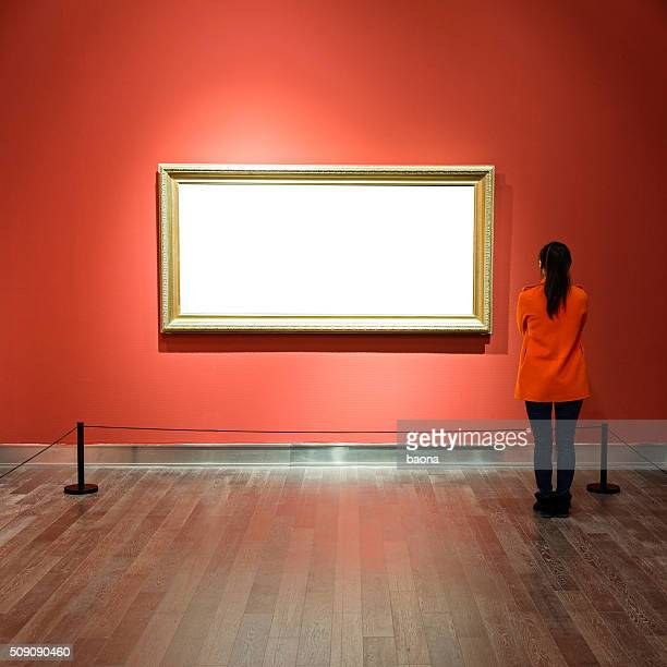 young woman looking at artwork - konstmuseum bildbanksfoton och bilder